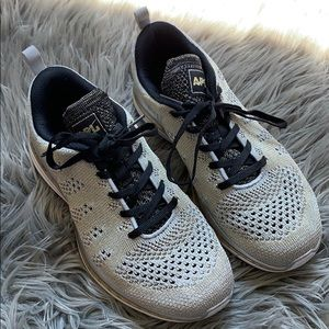 Gold and silver APL sneakers